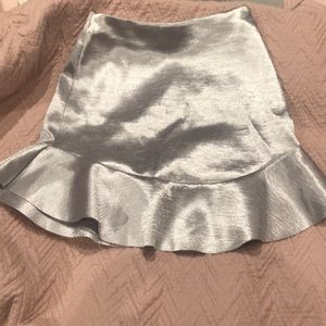 Silver shiny H & M skirt with slim fit and ruffles